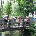 Family on Bridge Woodland Walk at Farmer Palmer's Poole Dorset