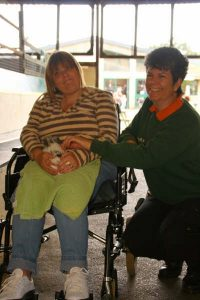 zena giving Farmer palmers experience to disabled person